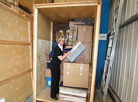 Customer loading an Economy Self Storage room